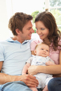 http://www.dreamstime.com/stock-photos-parents-cuddling-newborn-baby-boy-home-image15586853